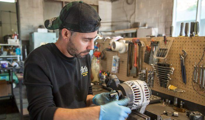 Art's Auto Electric technician repairing an alternator