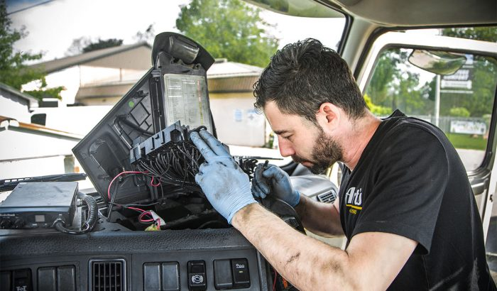 Lead technician wiring a semi truck at Art's Auto Electric